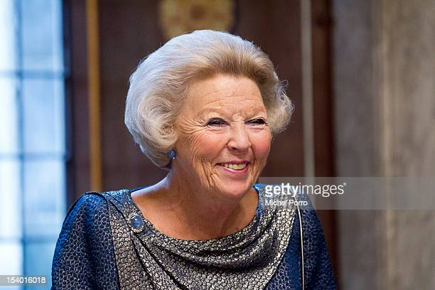 Queen Beatrix of The Netherlands presents the Painting Awards at Royal Dam Palace on October 12 2012 in Amsterdam Netherlands