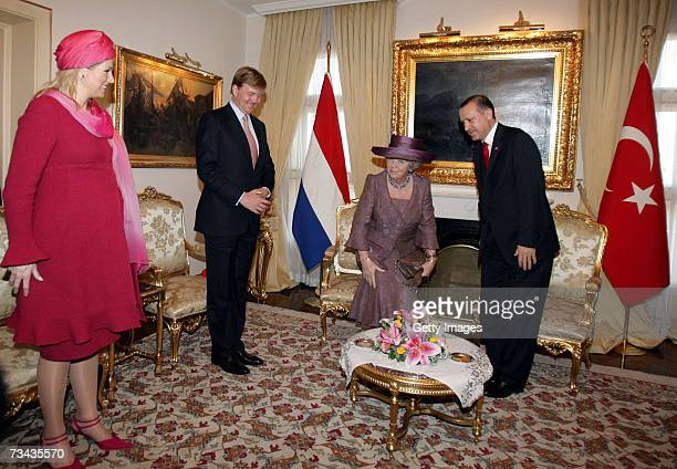 Queen Beatrix of the Netherlands Prince WillemAlexander of the Netherlands and Princess Maxima of the Netherlands are welcomed by the Prime Minister...