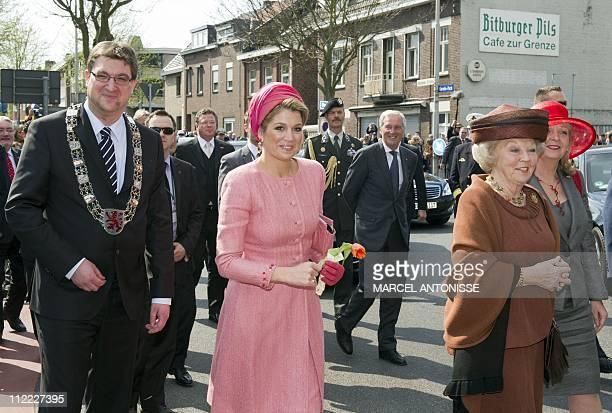 Queen Beatrix of the Netherlands Princess Maxima and Mayor Cristoph von der Driesch of Herzogenaurach walk between the German and Dutch border in...