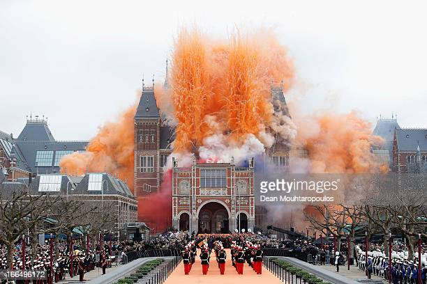 Queen Beatrix of the Netherlands sets the fireworks and smoke bombs to for the Rijksmuseum Official Opening on April 13 2013 in Amsterdam Netherlands...