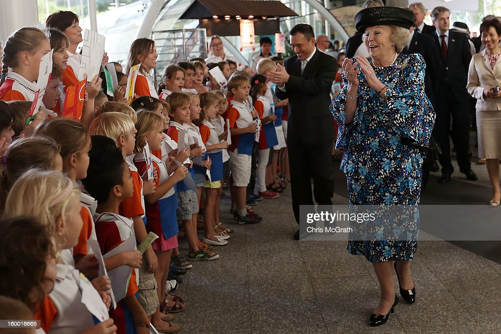 Queen Beatrix of the Netherlands sings along with dutch students from the Hollandse School after touring the Singapore A*Star Fusionworld on January 25, 2013 in Singapore, Singapore. Queen Beatrix is on a three day state visit to Singapore.