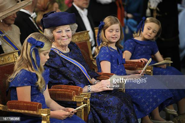 Queen Beatrix of The Netherlands sits with her granddaughters Princess Catharina Amalia Princess Alexia and Princess Ariane during the inauguration...