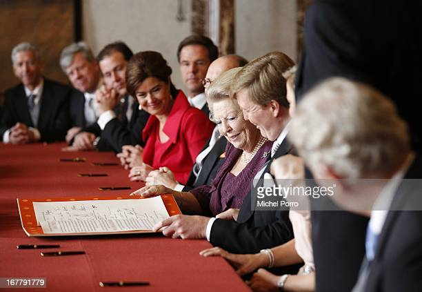 Queen Beatrix of the Netherlands smiles alongside her son Prince WillemAlexander of the Netherlands during the ceremony for her Act of Abdication in...