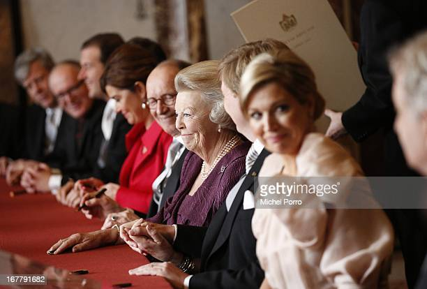 Queen Beatrix of the Netherlands smiles as she sits alongside Prince WillemAlexander of the Netherlands and wife Princess Maxima of the Netherlands...