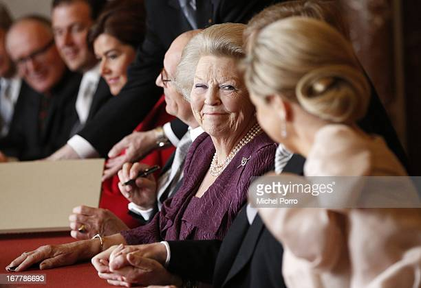 Queen Beatrix of the Netherlands smiles during the ceremony for the Act of Abdication in the Moseszaal at the Royal Palace on April 30 2013 in...