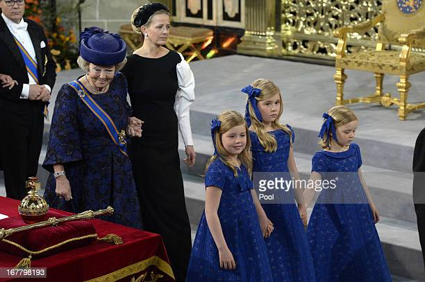 Queen Beatrix of The Netherlands stands with her granddaughters Princess Princess Alexia Catharina Amalia and Princess Ariane during the inauguration...