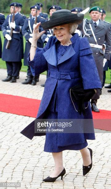 Queen Beatrix of the Netherlands walks past a guard of honor at Bellevue Presidential Palace on April 12, 2011 in Berlin, Germany. The Dutch royals...