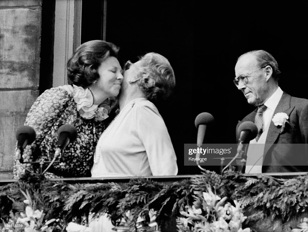 Queen Beatrix of the Netherlands with her mother, the former Queen Juliana, and her father Prince Bernhard, on the balcony of the royal palace in Amsterdam, the day after Beatrix took over from her mother as Queen, 1st May 1980.