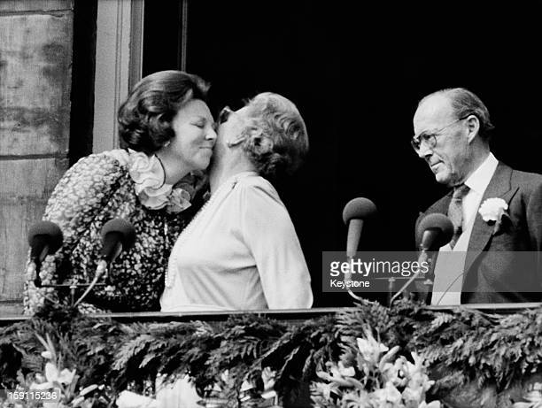 Queen Beatrix of the Netherlands with her mother the former Queen Juliana and her father Prince Bernhard on the balcony of the royal palace in...