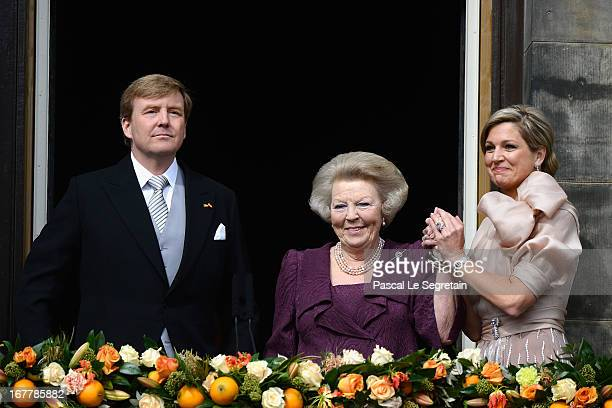 Queen Beatrix of the Netherlands with King Willem Alexander and Queen Maxima appear on the balcony of the Royal Palace to greet the public after her...