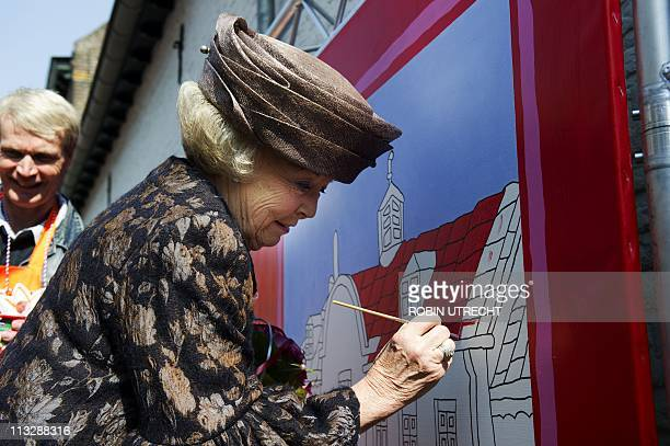 Queen Beatrix paints during the Queensday celebration in Weert on April 30 2011 AFP PHOTO/ANP/POOL/ROYAL IMAGES/ROBIN UTRECHT netherlands out belgium...