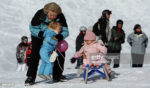 Queen Beatrix plays with Princess Ariane and Countess of Orange Leonore at the start of annual Austrian skiing holiday of the Dutch Royal family at...