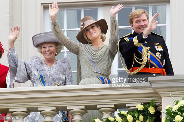Queen Beatrix, Princess Maxima and Crown Prince Willem Alexander of The Netherlands wave from the balcony of the Noordeinde Palace after the Queen's...