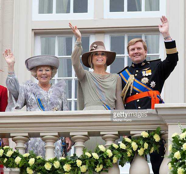 Queen Beatrix Princess Maxima and Crown Prince Willem Alexander of The Netherlands wave from the balcony of the Noordeinde Palace after the Queen's...