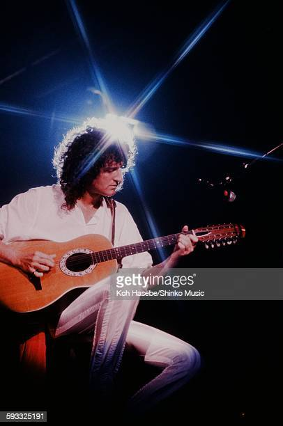 Queen Brian May live at Tokorozawa Seibu Lion's Baseball Stadium plays 12 string acoustic guitar Saitama November 3 1982
