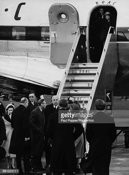Queen Consort Elizabeth waves from the ground as Princess Elizabeth boards her BOAC airplane to embark on a Commonwealth Tour Princess Margaret is...