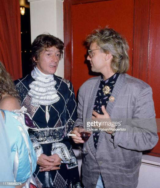 Queen drummer and vocalist Roger Taylor with actor John Hurt during the Chelsea Arts Ball at The Royal Albert Hall in London England on October 12...