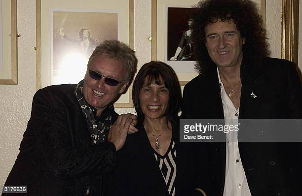 Queen drummer Roger Taylor Kashmira Cooke sister of Queen singer Freddie Mercury and Queen guitarist Brian May attend the First Anniversary Of...