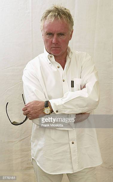 Queen drummer Roger Taylor poses for a photo backstage at the 46664 Give One Minute of Your Life to AIDS concert at Greenpoint Stadium on November 29...