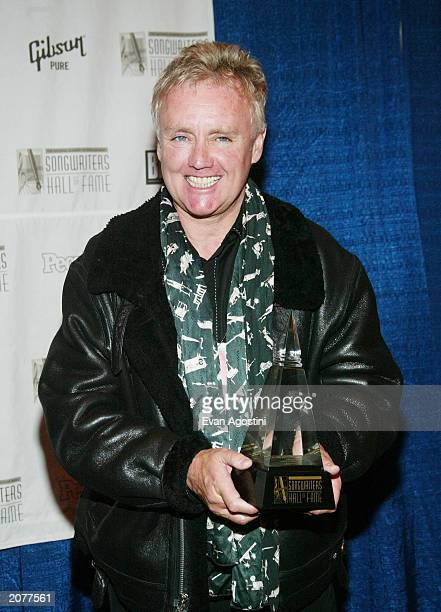 Queen drummer Roger Taylor poses in the press room at the Annual Songwriters Hall of Fame Awards ceremony and dinner at the Marriott Marquis June 12...