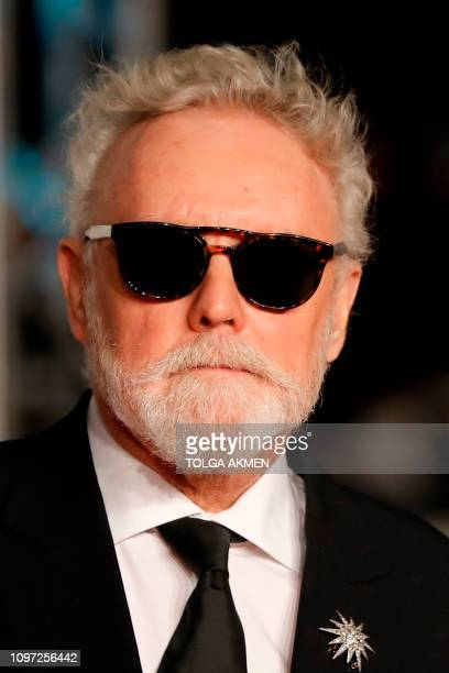 Queen drummer Roger Taylor poses on the red carpet upon arrival at the BAFTA British Academy Film Awards at the Royal Albert Hall in London on...