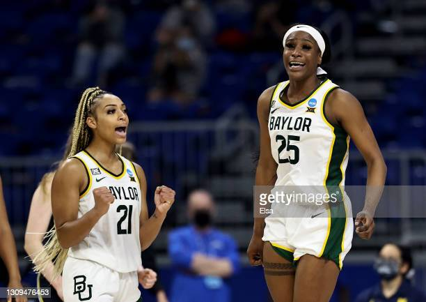 Queen Egbo and DiJonai Carrington of the Baylor Lady Bears celebrate the win over the Michigan Wolverines during the Sweet Sixteen round of the NCAA...