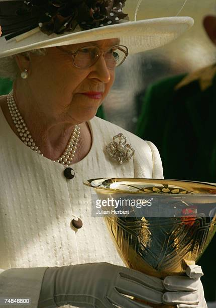 Queen Elisabeth II prepares to present The Ascot Gold Cup to connections of Yeats after his victory at Ascot Racecourse during the Third day of The...
