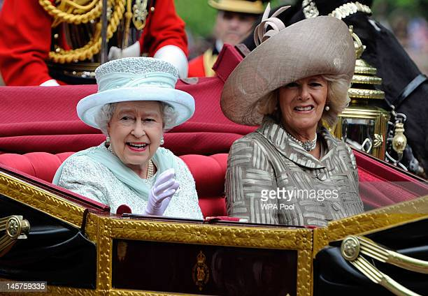 Queen Elizabeth and Camilla, Duchess of Cornwall pass the mall after Diamond Jubilee service of thanksgiving at St.Paul's Cathedral during the...