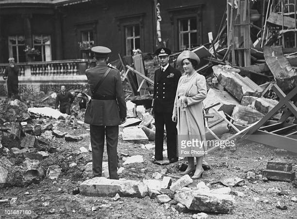 Queen Elizabeth and King George VI inspect the bomb damage at Buckingham Palace in London after an air raid during the Blitz 10th September 1940