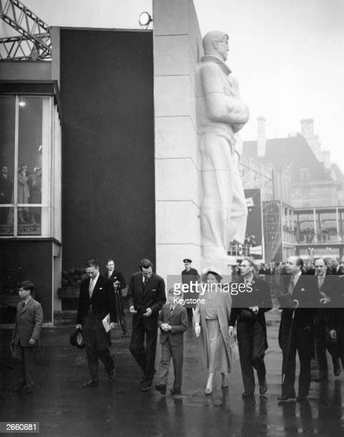 Queen Elizabeth and King George VI touring a Festival of Britain Exhibition Site on London's South Bank with members of the extended Royal Family