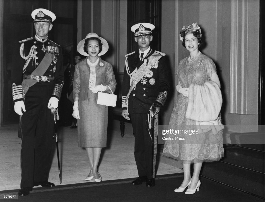 Queen Elizabeth and Prince Philip at Buckingham Palace with Queen Sirikit and King Bhumibol Adulyadej (1927 - 2016) of Thailand, after the processional drive from Victoria station on the occasion of their state visit, 19th July 1960.