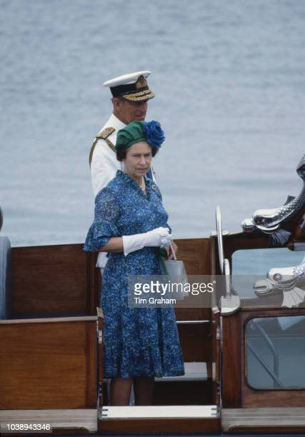 Queen Elizabeth and Prince Philip on board the royal barge as they arrive in Fiji from the Royal Yacht Britannia, 30th October 1982. The Queen is on...