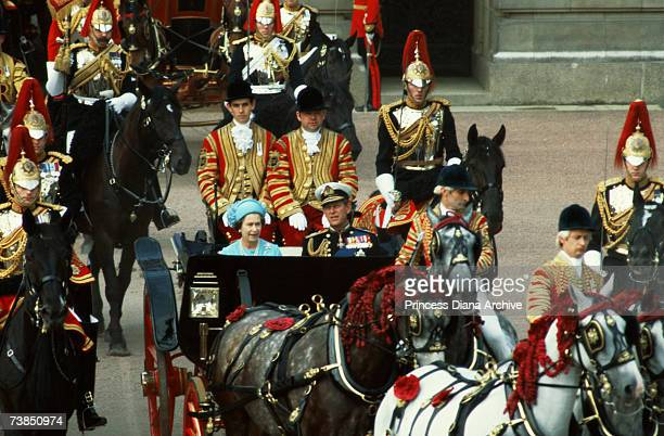 Queen Elizabeth and Prince Philip ride in procession to St Paul's Cathedral London where their son Prince Charles is to marry Lady Diana Spencer 29th...