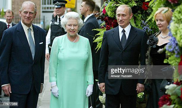 Queen Elizabeth and the Duke of Edinburgh are greeted by Russia's President Vladimir Putin and his wife Lyudmila Putina as they arrive for a banquet...