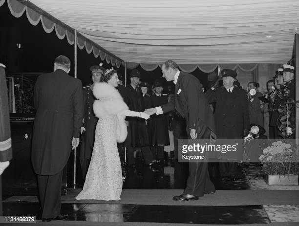 Queen Elizabeth arrives at the Royal Film Performance of George Cukor's 'Les Girls' at the Odeon Leicester Square London 4th November 1957 She is...