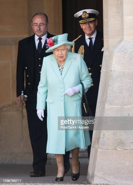 Queen Elizabeth arrives to present the insignia of Knight Bachelor to Captain Sir Thomas Moore during an investiture ceremony at Windsor Castle on...
