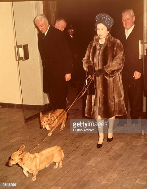 Queen Elizabeth at Liverpool Street Station with two of her pet Corgis