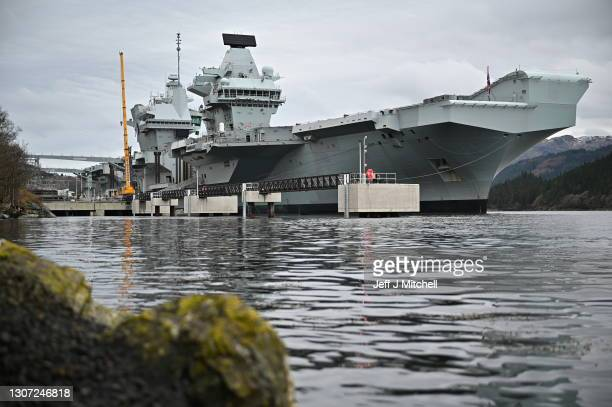 Queen Elizabeth berthed on Loch Long on March 15, 2021 in Glenmallan Scotland. The Royal Navy aircraft carrier, HMS Queen Elizabeth, is berthed at...
