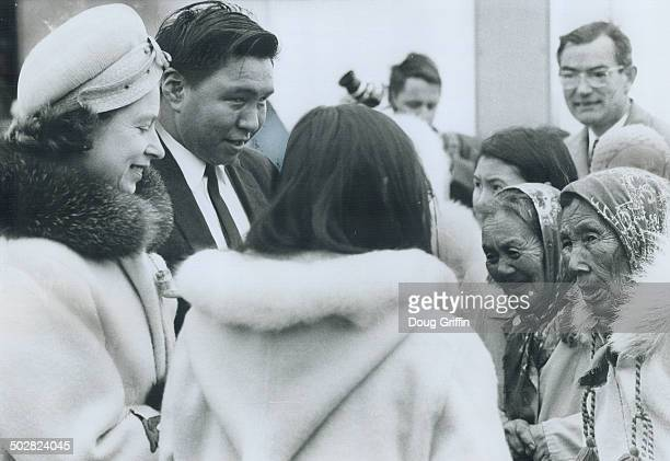 Queen Elizabeth chats with Eskimo women in the left photo during her visit to Frobisher Bay's Eskimo museum yesterday The Queen was later presented...