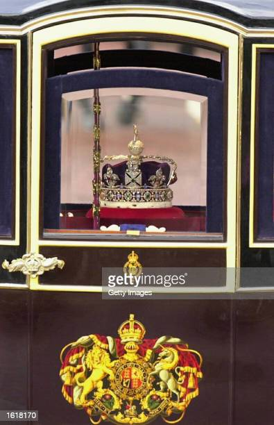 Queen Elizabeth' crown and scepter is driven in a coach down The Mall in London on November13, 2002 as part of the opening of Parliament.