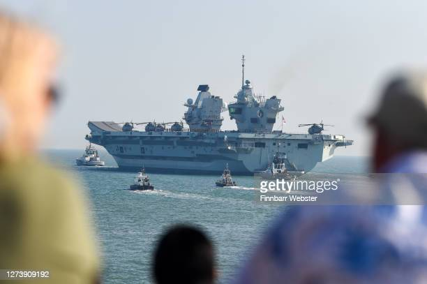 Queen Elizabeth departs from the Naval base on September 21 2020 in Portsmouth England The £3 billion aircraft carrier was due to sail last week but...