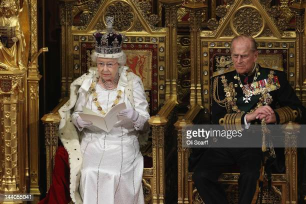 Queen Elizabeth II accompained by Prince Philip the Duke of Edinburgh delivers her speech in the House of Lords during the State Opening of...