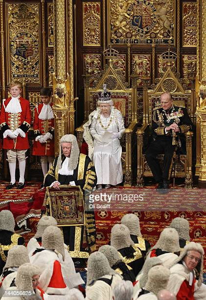 Queen Elizabeth II, accompained by Prince Philip, the Duke of Edinburgh, recieves her speech from Lord Chancellor Kenneth Clarke during the State...