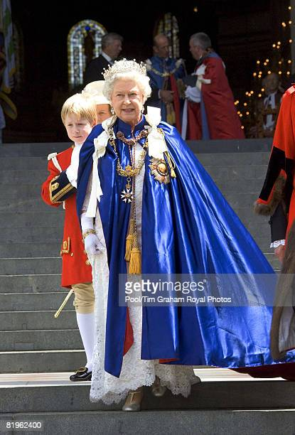 Queen Elizabeth II, accompanied by a Royal Page who holds her train, leaves St Paul's Cathedral after attending the Order of St Michael and St George...