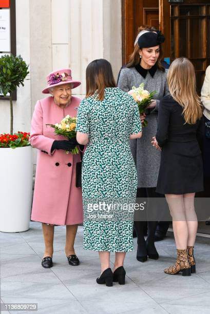 Queen Elizabeth II accompanied by and Catherine, Duchess of Cambridge visit King's College London on March 19, 2019 in London, England to officially...