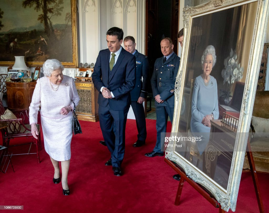 Queen Elizabeth II Is Presented With A New Portrait To Celebrate 75th Anniversary Of The RAF : News Photo