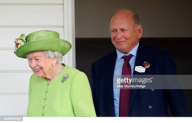 Queen Elizabeth II, accompanied by Brian Stein, Chairman of Guards Polo Club, attends the Out-Sourcing Inc. Royal Windsor Cup polo match and a...