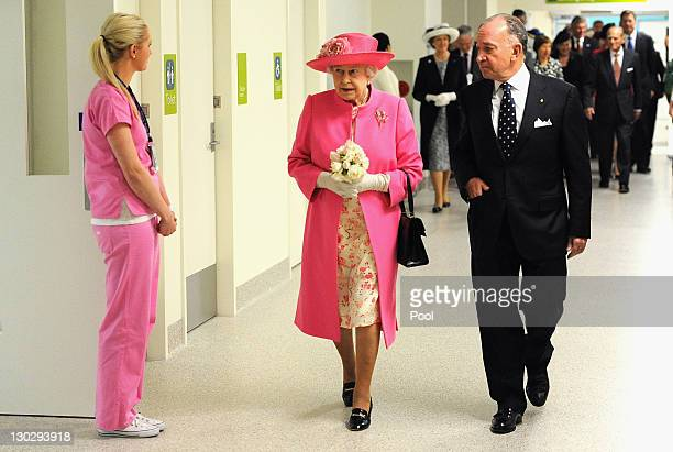 Queen Elizabeth II accompanied by Chairman Tony Beddison inspects the new Royal Children's Hospital on October 26 2011 in Melbourne Australia The...