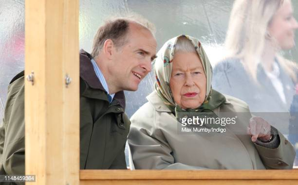 Queen Elizabeth II, accompanied by Donatus, Prince and Landgrave of Hesse, watches her horse 'Balmoral Mandarin' compete in the BSPS Ridden Mountain...