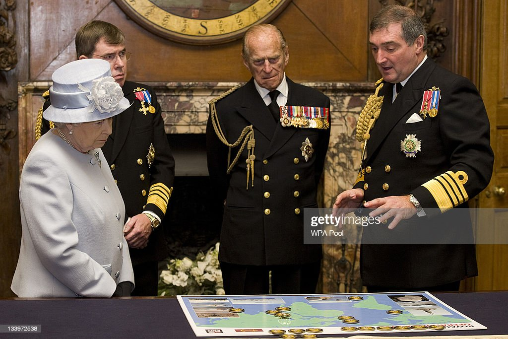 Queen Elizabeth II accompanied by First Sea Lord, Admiral Sir Mark Stanhope (2L) and her husband Prince Philip, Duke of Edinburgh, are shown a map detailing current naval deployments by Admiral Sir Trevor Soar (R) during a visit to the Admiralty Board and Admiralty House on 23 November, 2011 in London, England. The Duke of Edinburgh was inaugurated as Lord High Admiral as well as formally receiving the Letters Patent, followed by a lunch given by the First Sea Lord at Admiralty House.
